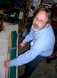 Cagle's Billiards employee repairing pool table