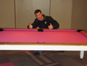 Cagle's Billiards employee working on billiard table repair