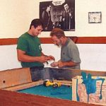 Cagle's Billiards employees repairing billiard table